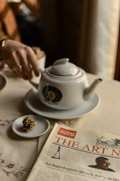 White Ceramic Teapot on Table