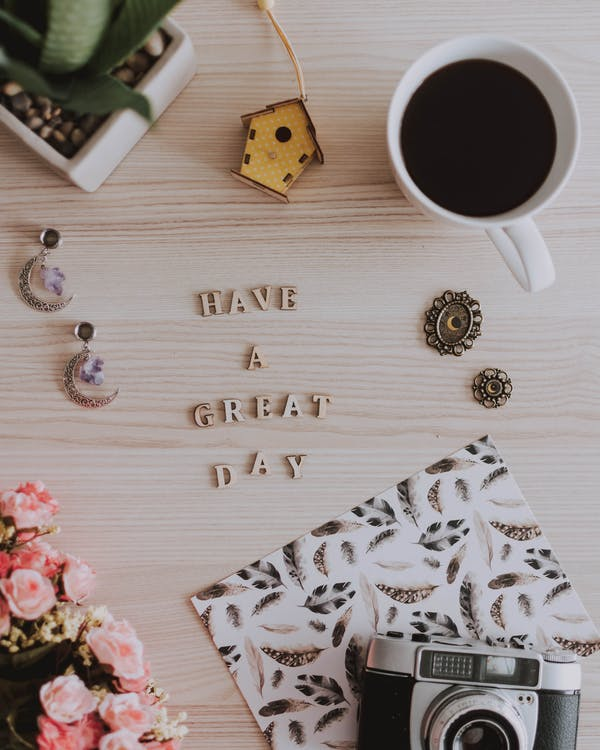 Have A Great Day Text Beside White Ceramic Mug With Coffee