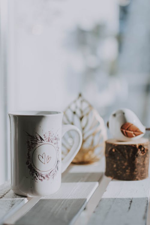 White Ceramic Mug on Wooden Table