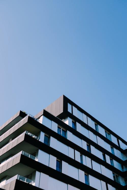 White and Black Concrete Building Under Blue Sky