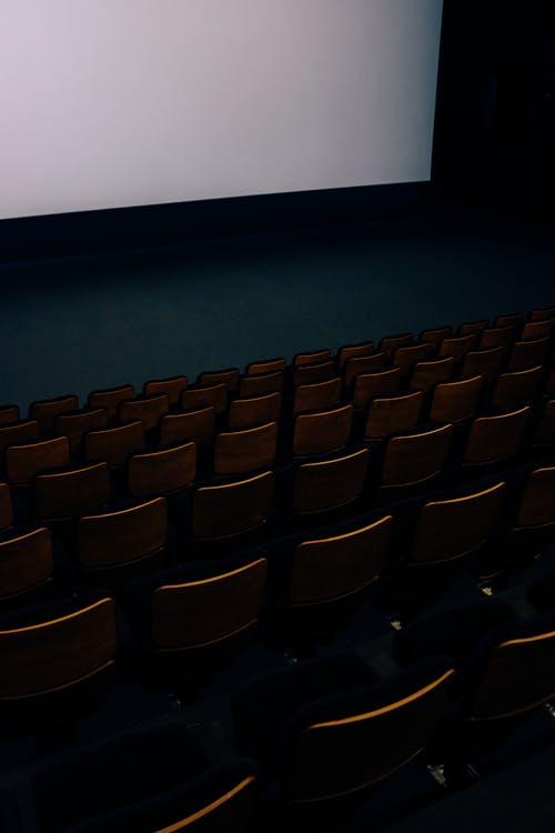 Black Chairs in Front of White Projector Screen