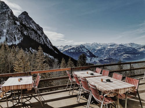 Restaurant Near Mountains Covered with Snow