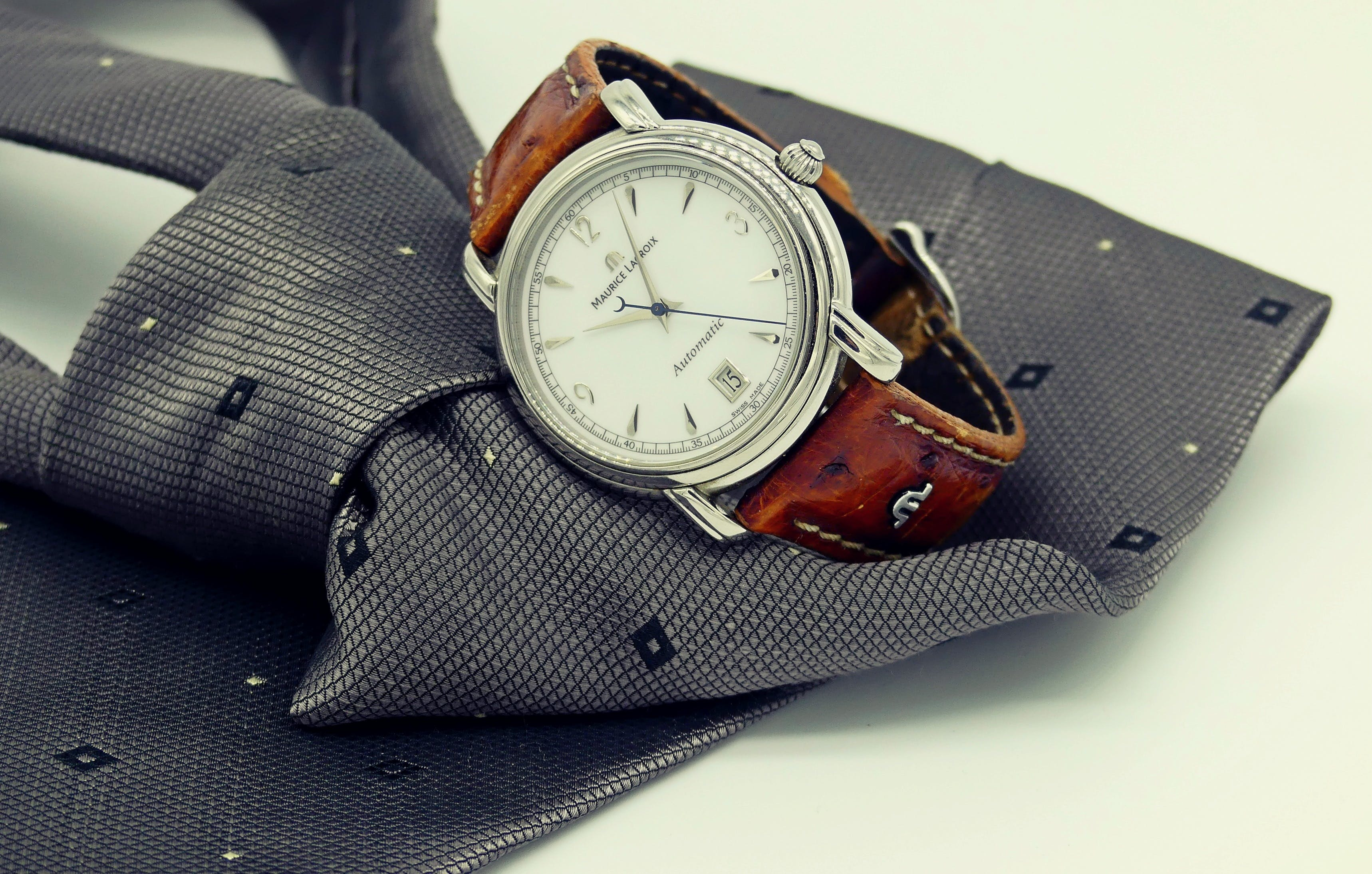 Round Silver-colored Analog Watch With Brown Leather Strap