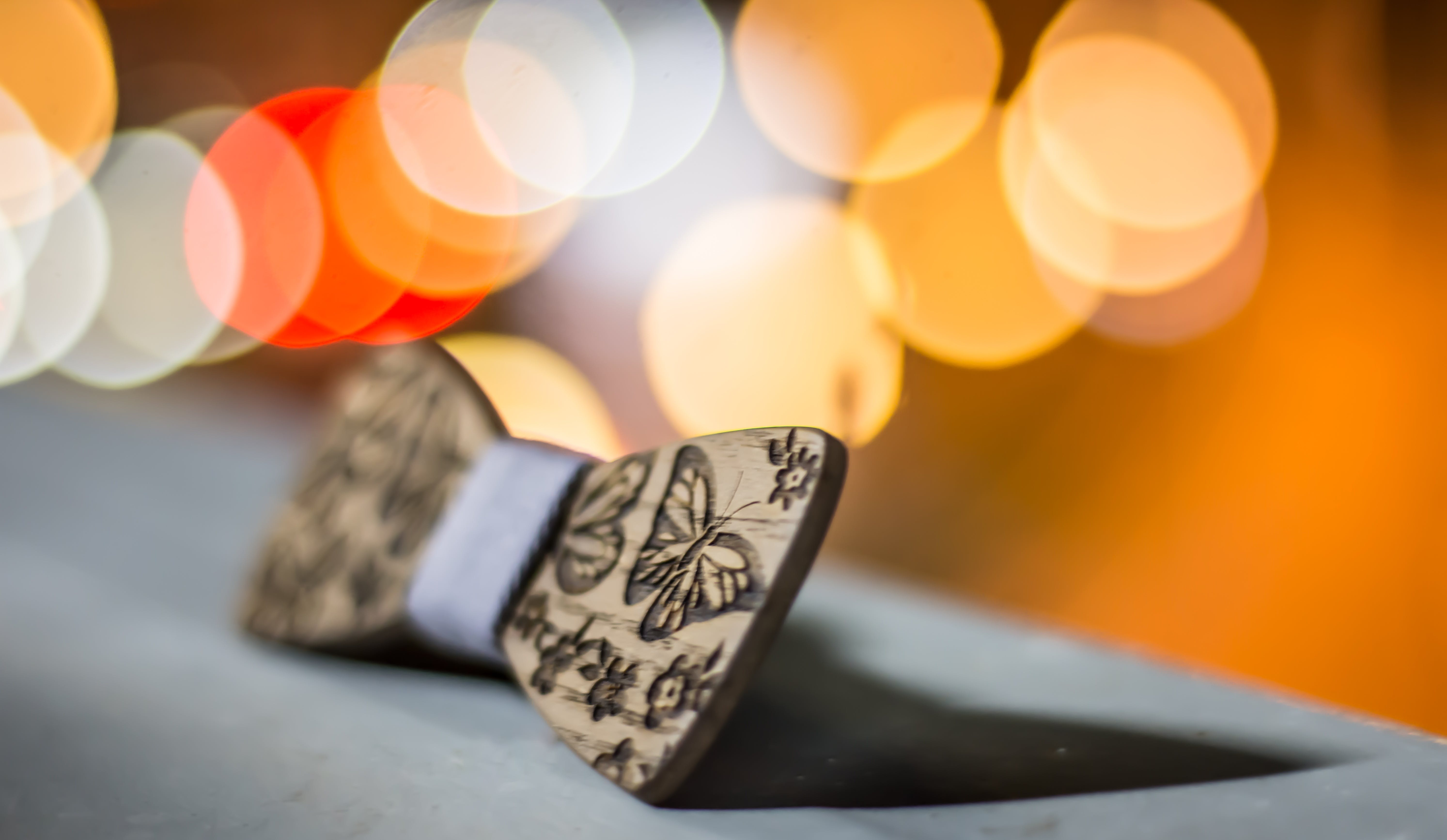 Selective Focus Photography of Bow Tie Decor