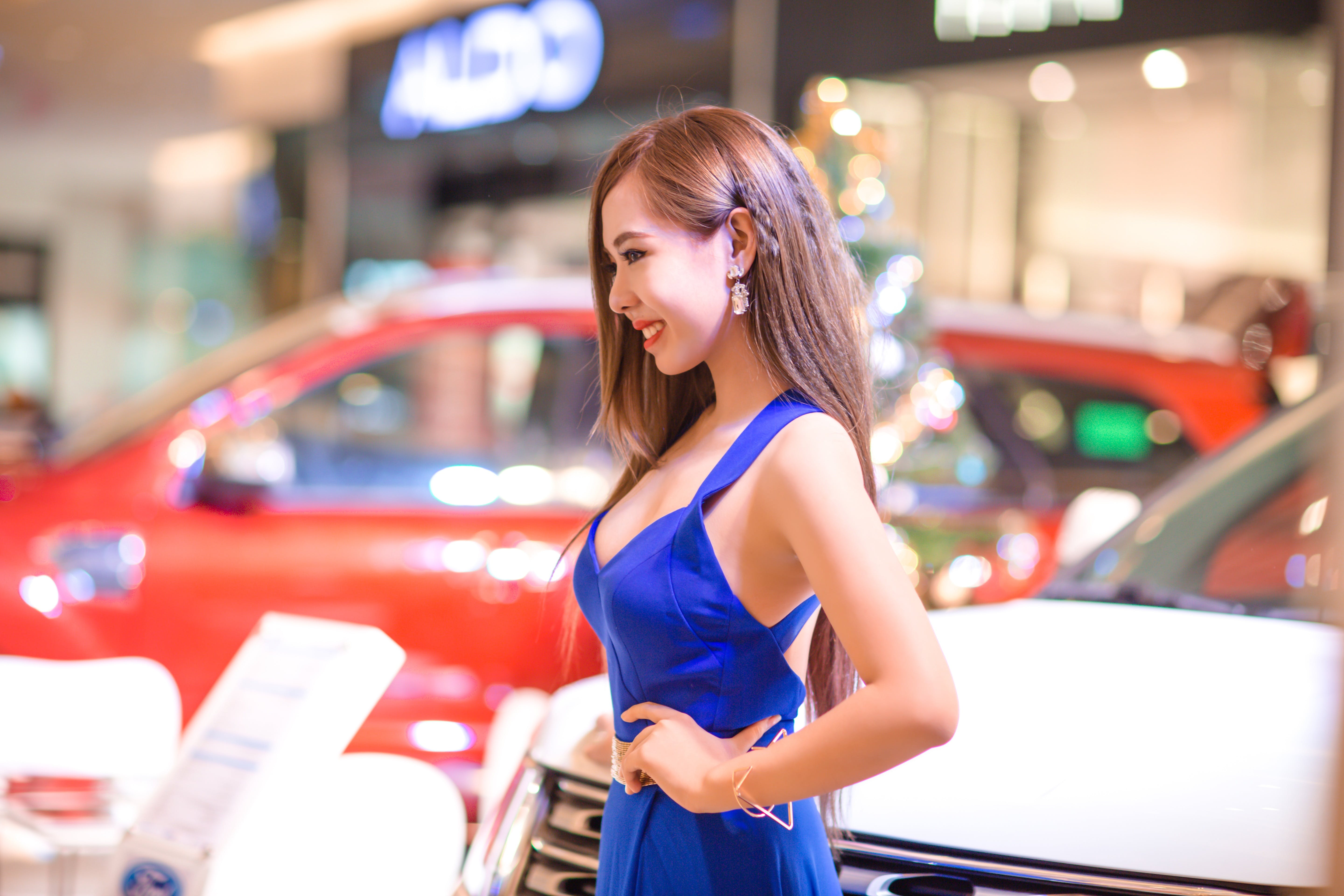 Woman Standing Near Car While Left Hand on Her Lest Waist
