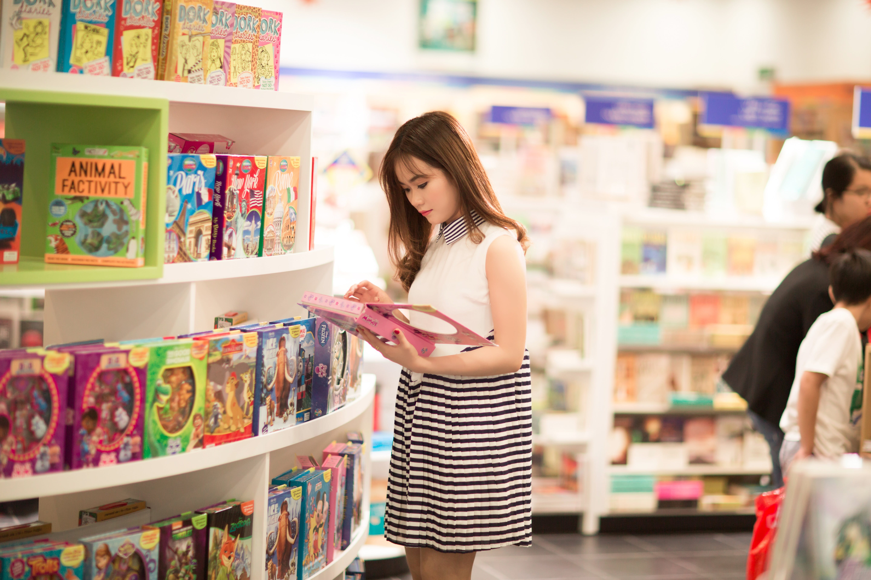 Women Holding Pink Book