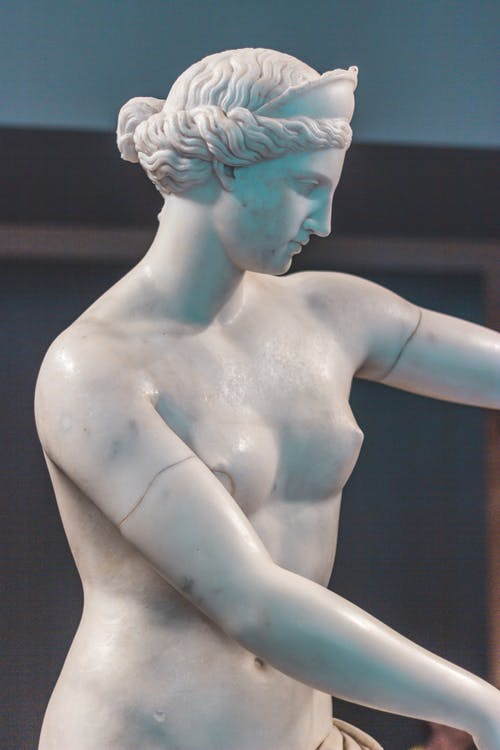 White Ceramic Statue of a Woman