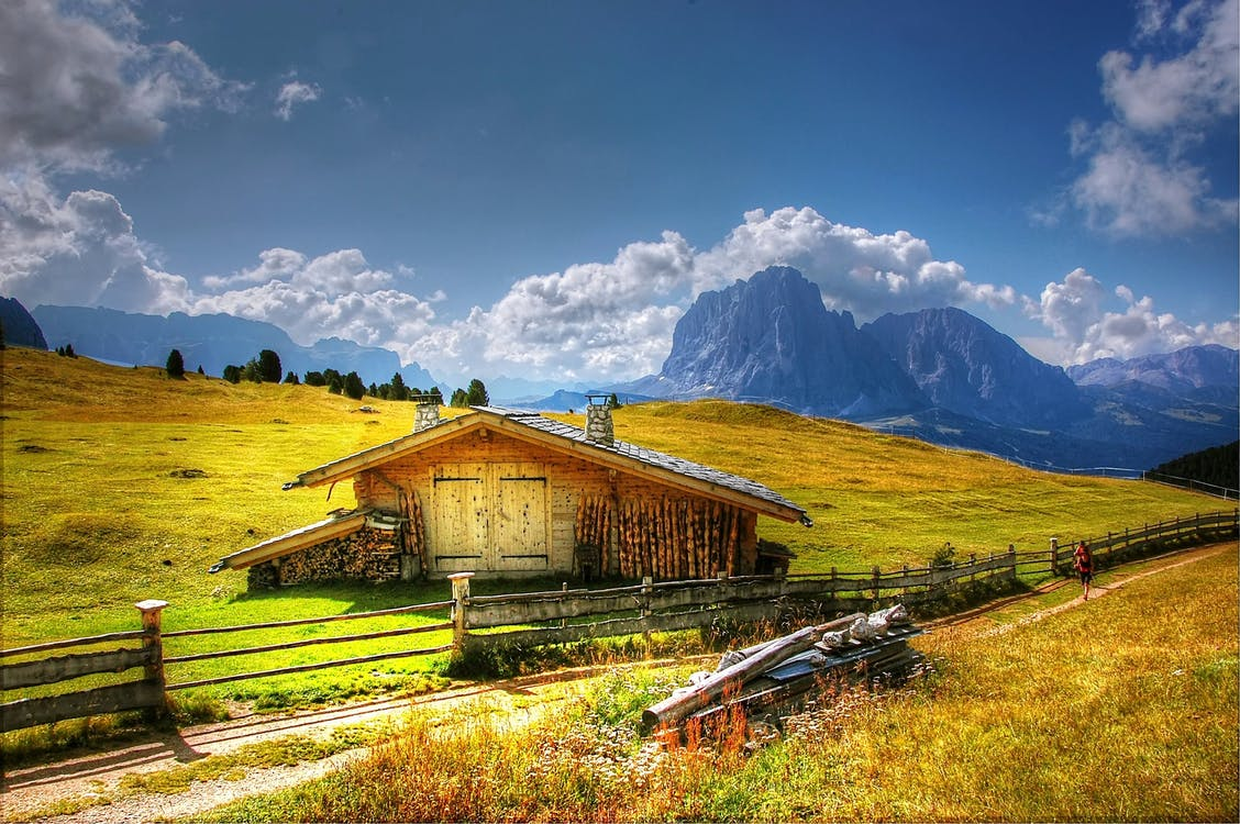 Brown House on Green Grass Field