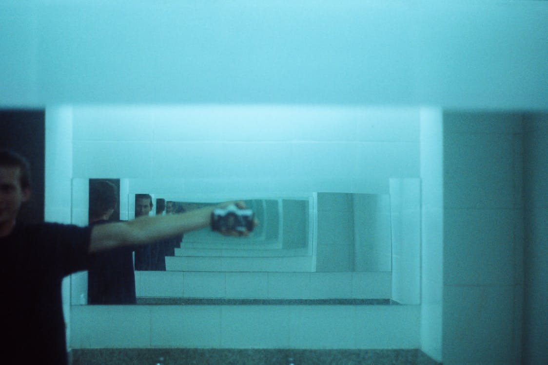 Man Taking Photo Of Himself At The Mirror