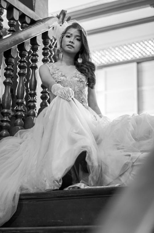 Grayscale Photo of Woman in White Floral Wedding Dress