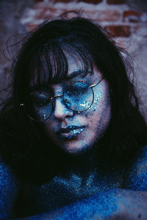 Woman Wearing Eyeglasses Covered with Blue Dust