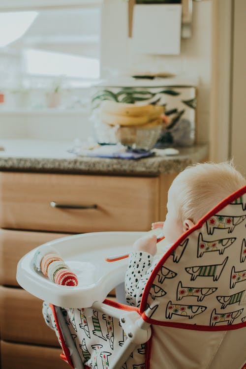 Baby in a Feeding Chair