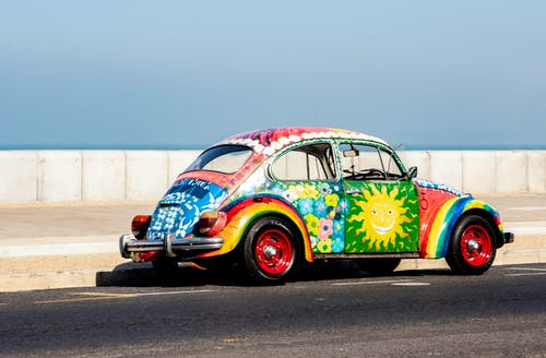 Multicolored Volkswagen Beetle on Road