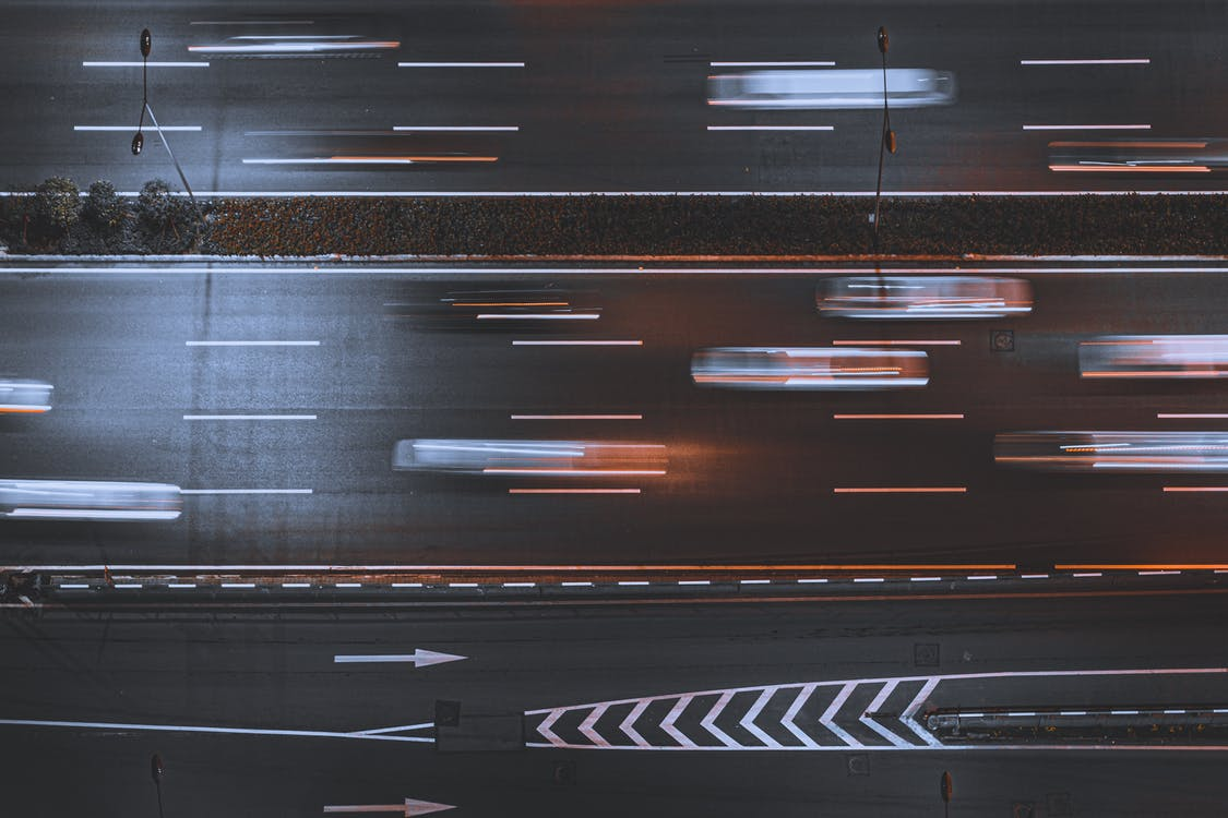 Time-lapse Photo Of Cars In Asphalt Road