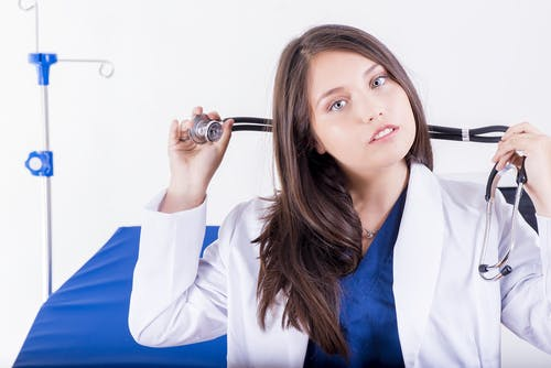 Woman Holding Black Stethoscope