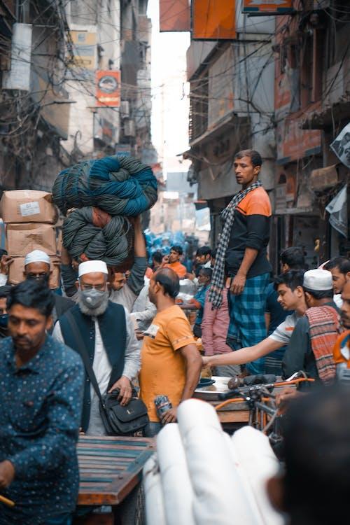 People walking on busy street in Asia