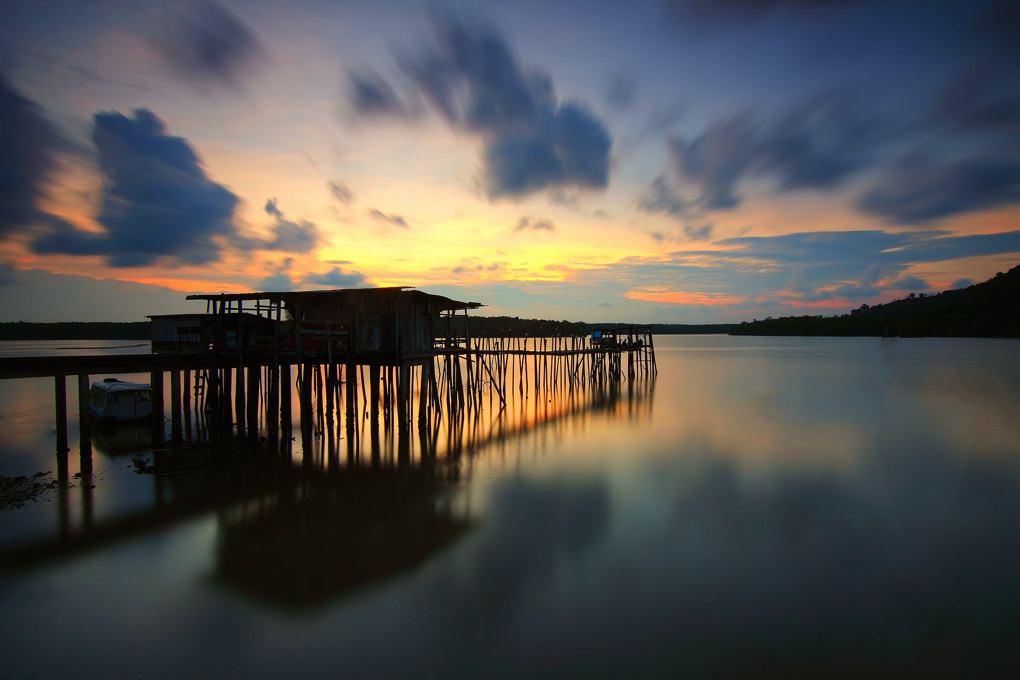 Brown Wooden Dock Silhouette during Golden Hour