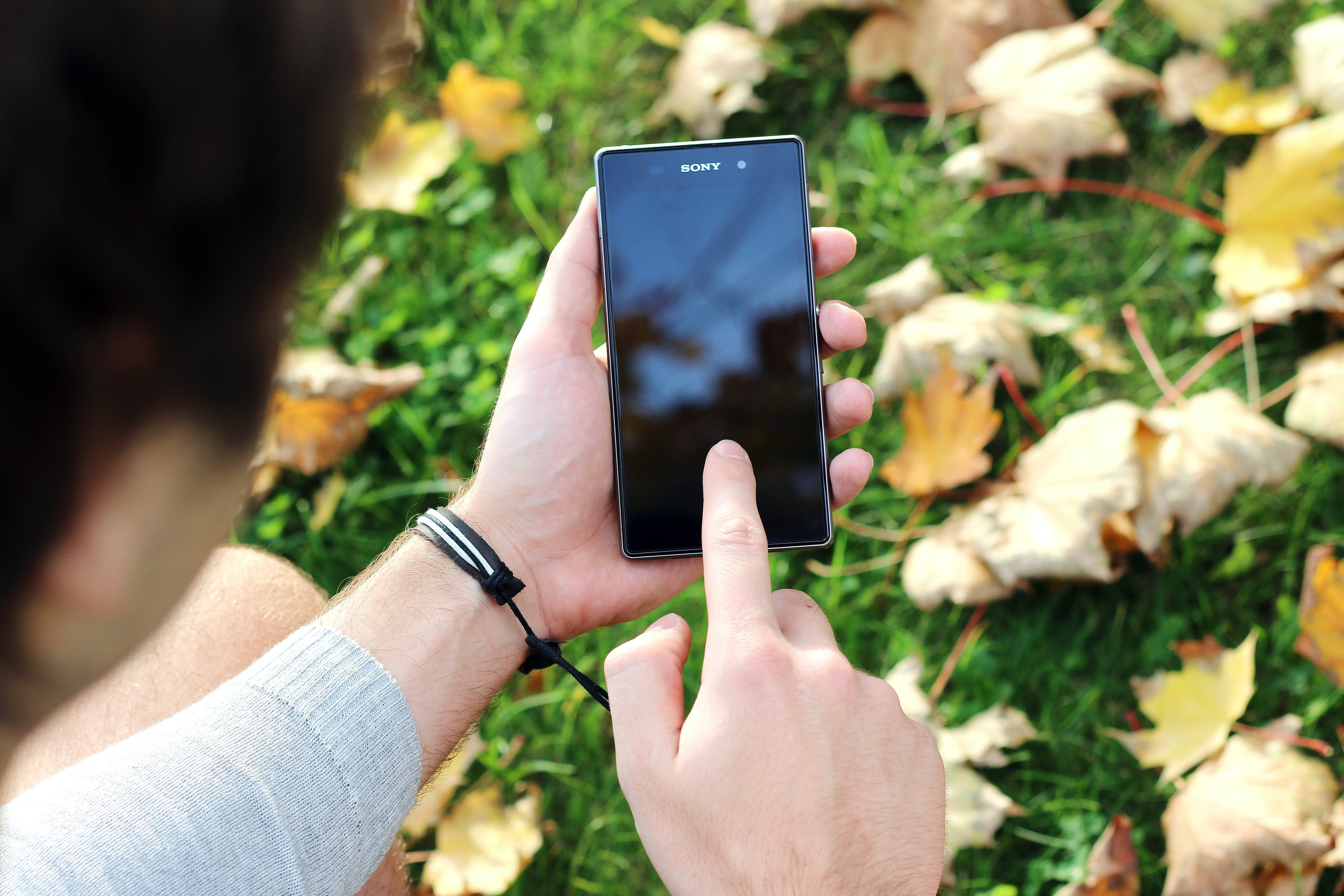 Person Using the Black Sony Android Smartphone