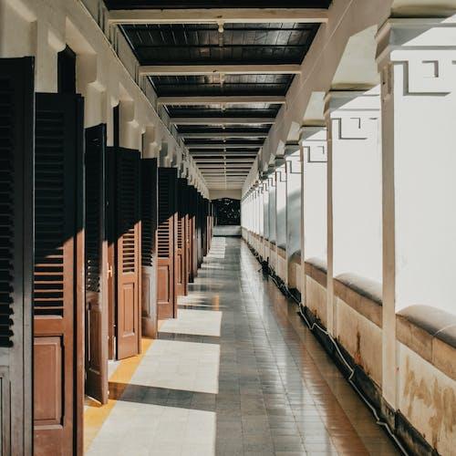 Empty corridor of building in sunlight