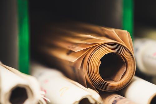 Stack of paper rolls in shelf