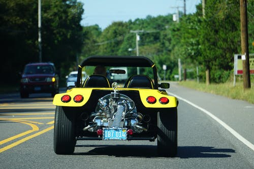 Yellow and Black Convertible Car on Road