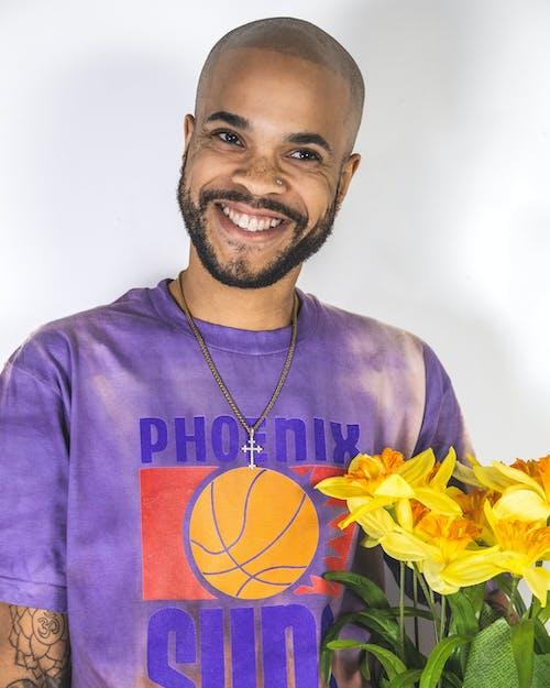 Man in Purple Crew Neck Shirt Smiling