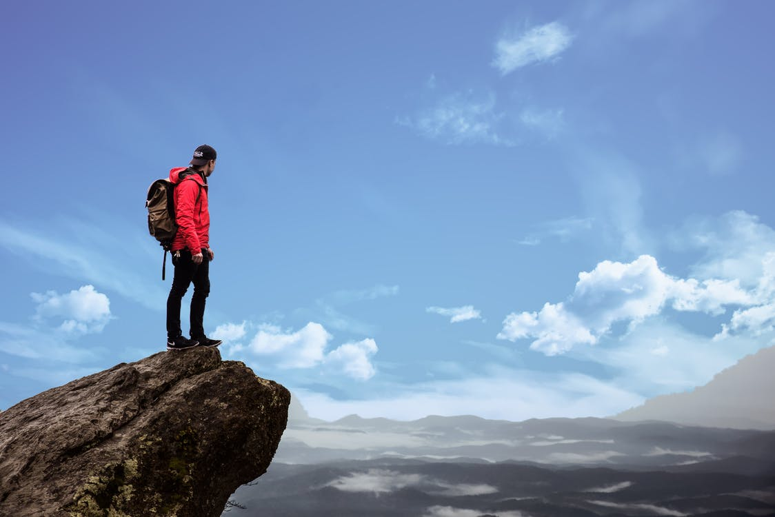 Man Standing on Cliff Photography