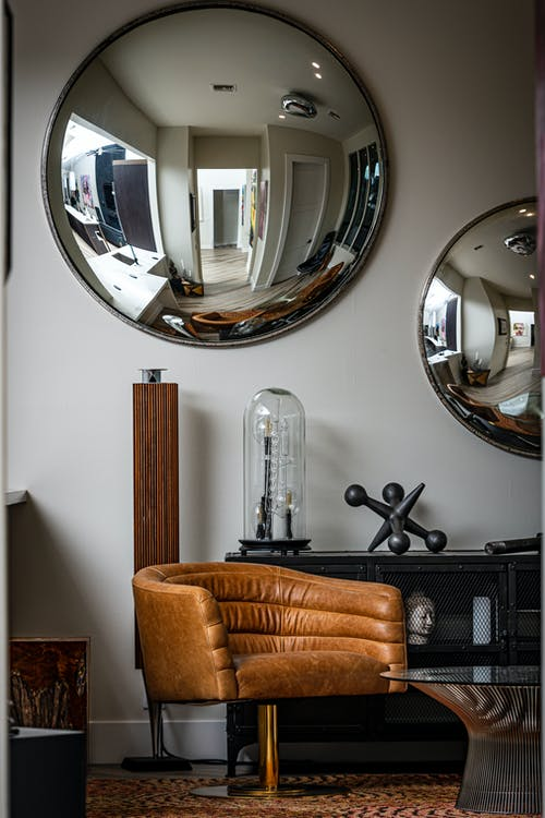 Stainless Steel Round Mirror on White Wall