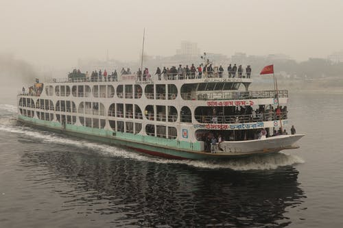 White River Boat with People on Water