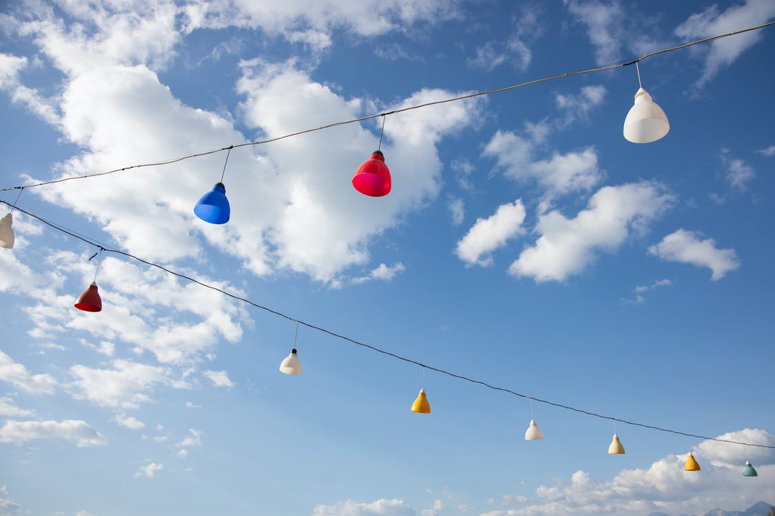 Red Blue Yellow and White Balloons on Wire