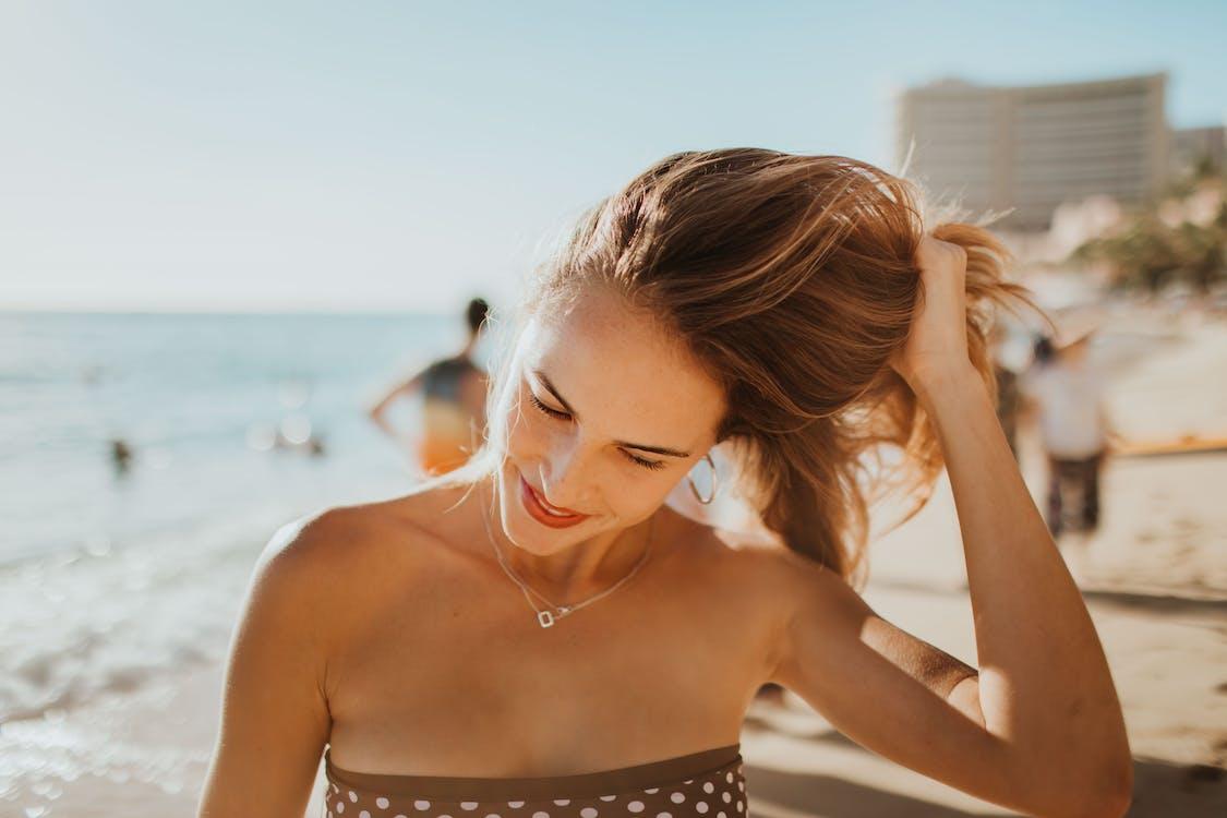 Woman In Polka Dot Bikini Top At The Beach
