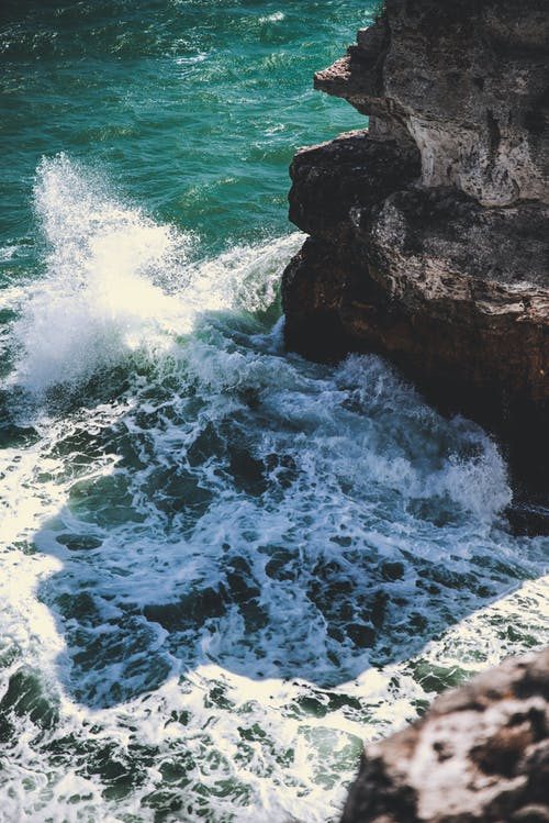 Ocean Waves Crashing on Rocky Shore