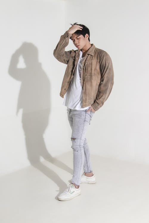 Man in Brown  Jacket and  Denim Jeans Standing