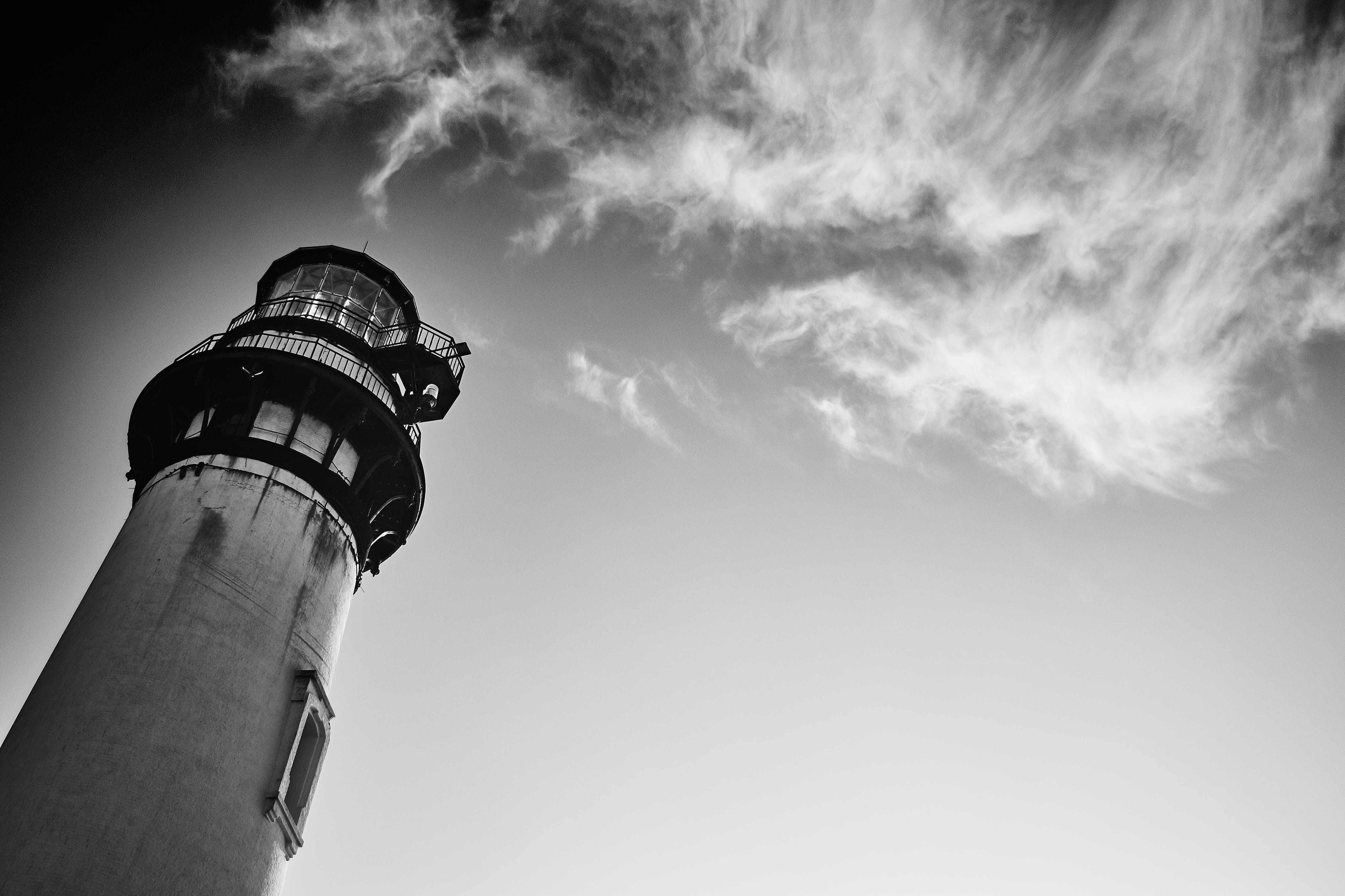 Gray Scale Low-angle Photography of Lighthouse