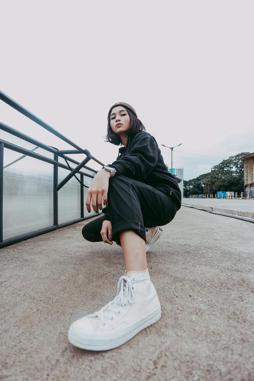 Woman In Black Jacket And White Sneakers