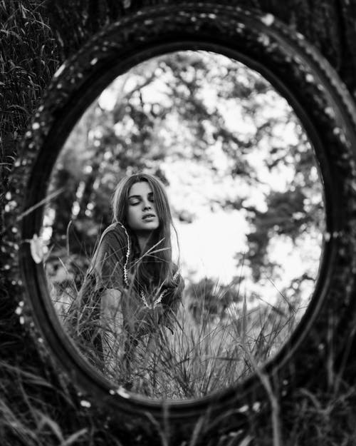 Grayscale Photo Of Woman's Reflection