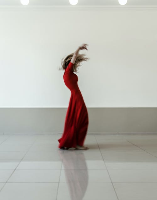 Woman In Red Dress Standing