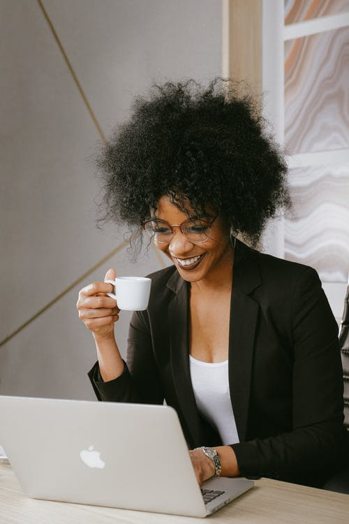 Woman In Black Blazer Holding White Ceramic Mug