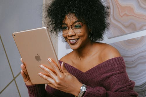 Smiling Woman Holding An Ipad