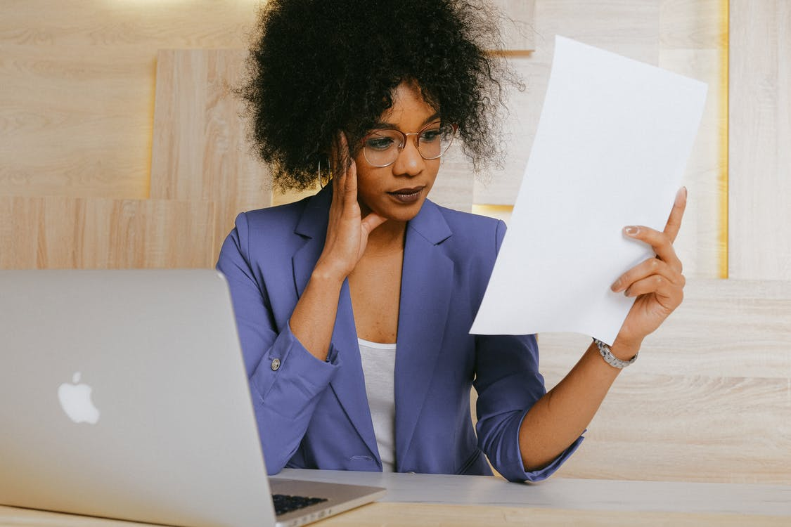 Woman In Blue Blazer Holding White Paper