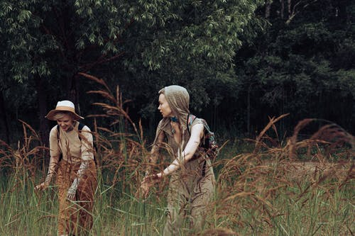 Women Standing in Grass Field