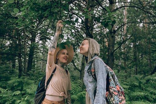 Photo of Women Standing Near Green Leaves