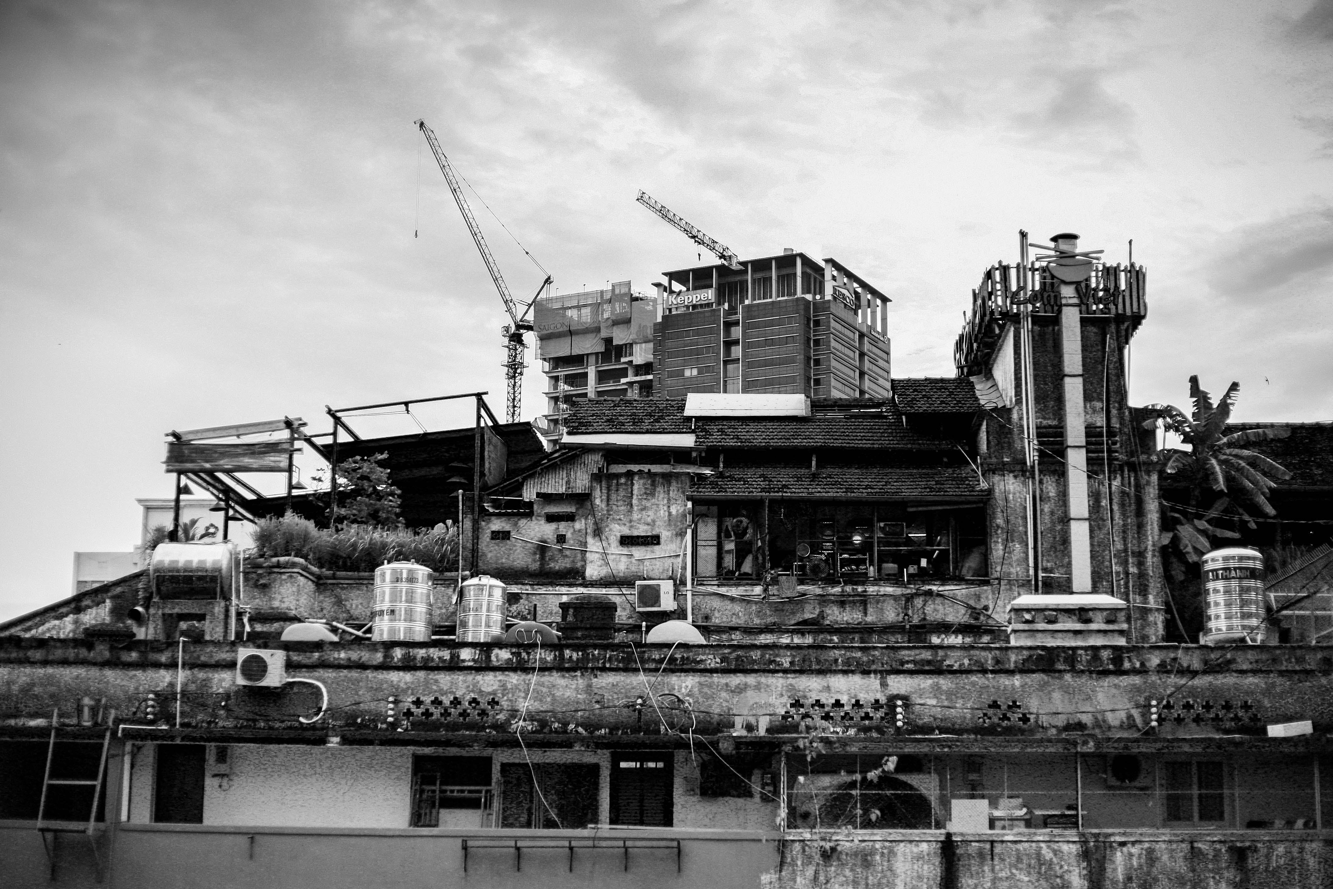 Grayscale Photography of Building With Tower Crane