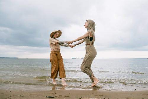 Photo of Women Standing on Beach