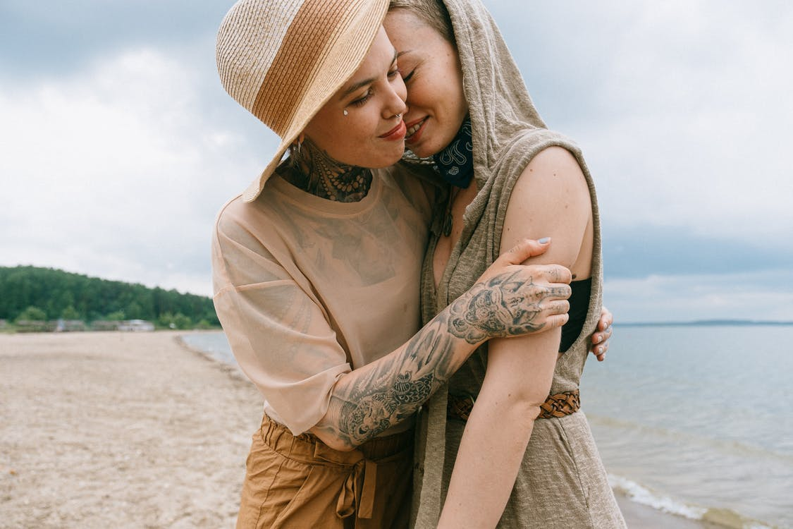Woman Hugging Another Woman