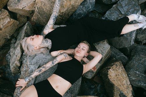 Women Lying on Rocks