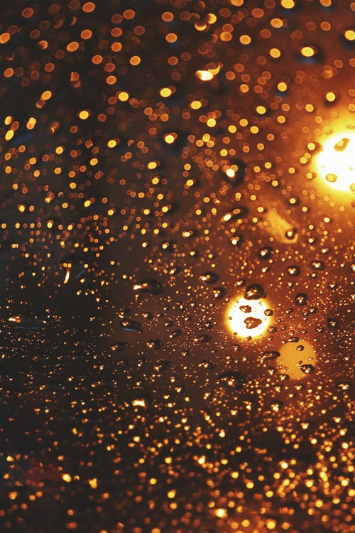 Water Droplets on Glass during Night Time