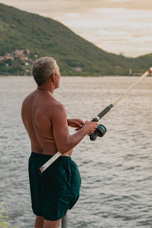 Man Holding Fishing Rod
