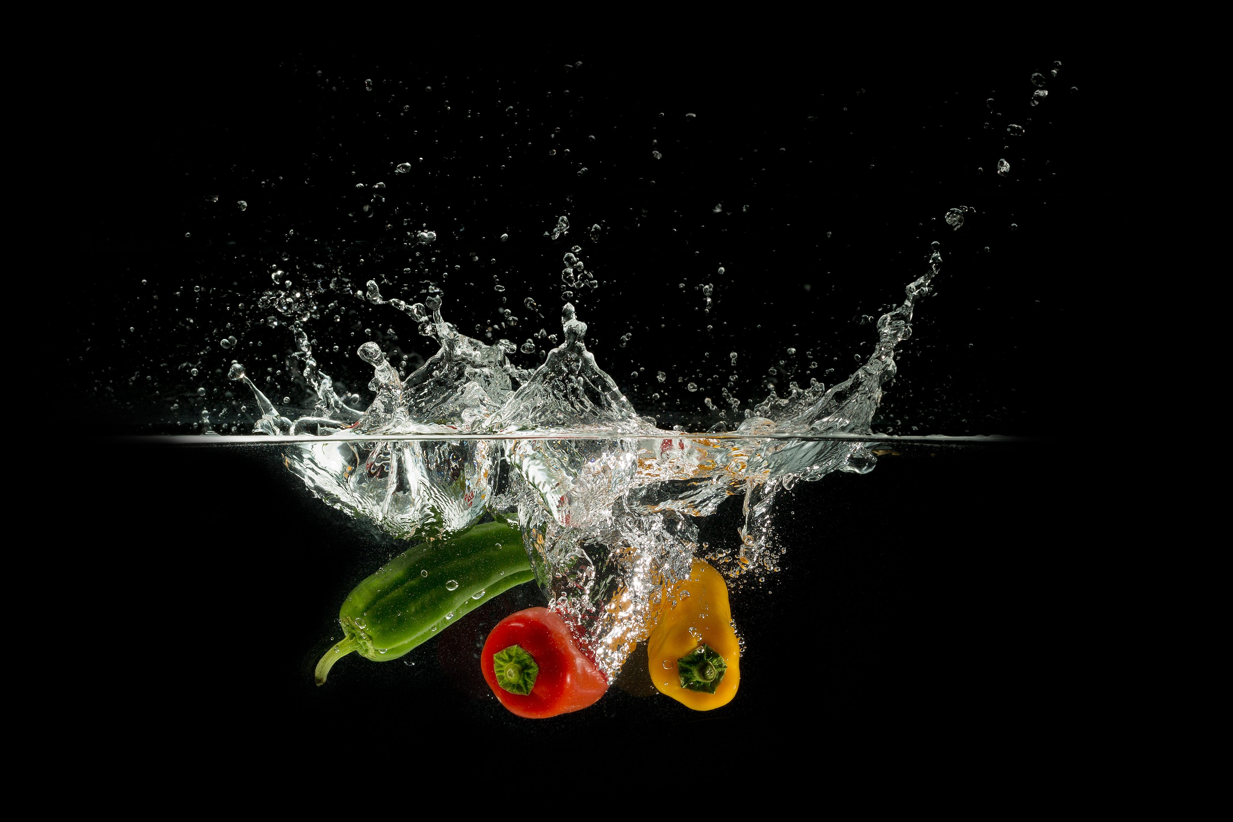 Bell Peppers Dropped on Water