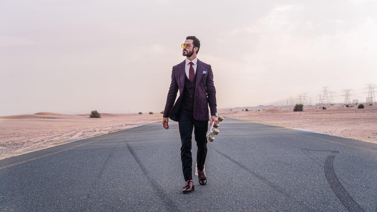 Man Walking on Road